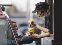 a fast-food employee gives a customer her order